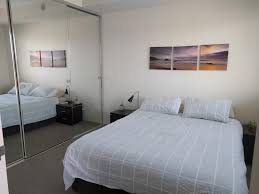a bed or beds in a room at 2 bed modern inner city apt riverside