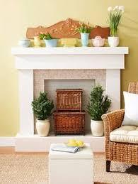 Best 25+ Empty fireplace ideas ideas on Pinterest   Logs in fireplace,  Decorative fireplace logs and Fireplace filler