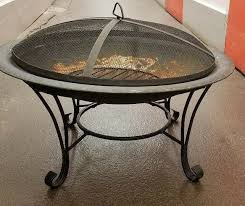 wrought iron fire pit with screen and grate 26 inches wide