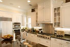 california style decor kitchen tropical with glass door cabinets off white walls stainless steel appliances