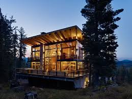 View in gallery Large glass windows that open up towards the forest blend  privacy with scenic views