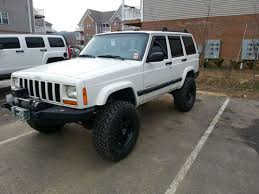 1999 lifted white jeep cherokee xj 4 door us 8 000 00
