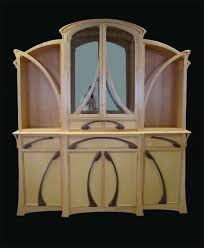 art nouveau dining room set. [tiger maple breakfront]. this design is part of an art nouveau dining room set r