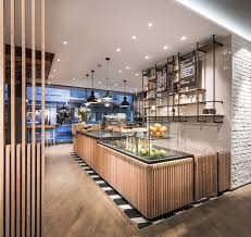 cafe lighting furniture. a thematically adapted ceiling element with unusual catenary lights supports the cosy atmosphere golden accents cafe lighting furniture