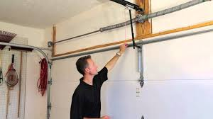 garage door braceIs your garage door properly reinforced to work with your opener