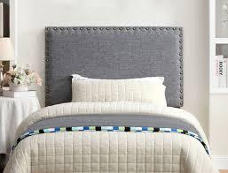 grey fabric upholstered headboard  caravana furniture