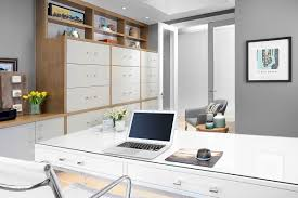 home office it. Custom-built Cabinetry Lines The Wall Of This Modern Office. It Carries Solid Wood With White Drawer Front Theme Seen In Kitchen. Home Office