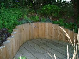 Retaining Wall Seating Image Result For Stacked Logs As Retaining Wall Landscaping