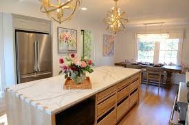 quartz countertops. All Of The Above Countertops Are Statuary Quartz From Daltile. Is Bright White With A Greyish-blue Veining. It Looks AMAZING In Kitchens