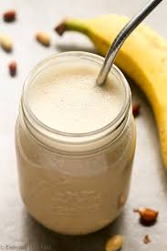 overhead view of peanut er banana protein shake recipe in a mason jar with a metal