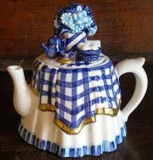 Tea Table Small Decorative Ceramic Teapot w Blue and White Plaid Tablecloth