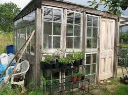 wow a greenhouse made from old wooden windows and door its a greenhouse windows