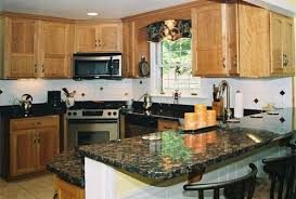 this kitchen features haas pennsylvania cherry arched full overlay cabinets with tan brown granite countertops with a square eased edge