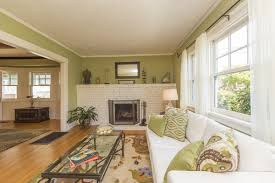 calming green and white living room decor wood flooring area rug