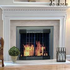 fenwick fireplace doors pleasant hearth cabinet fireplace screen and arch prairie smoked glass doors oil rubbed