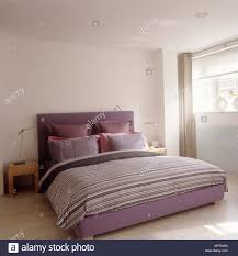 pink upholstered bed. Pink Upholstered Bed With Stripe Cover