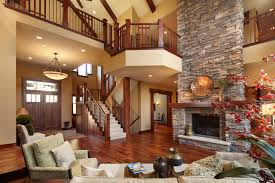 Two Story Fireplace And BuiltIn BookshelvesTwo Story Fireplace