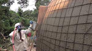 Inflatable Concrete Monolithic Dome Construction With A Stucco Sprayer Hildebrand