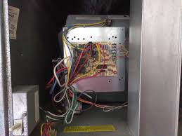 hvac the wires connecting to the blue terminal block on the upper right of the board lead to the thermostat the fan enclosure is directly