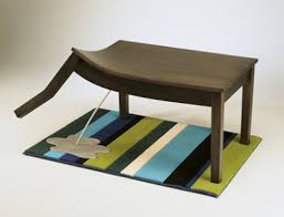 Whimsical optical illusion furniture. The bench you peel away.