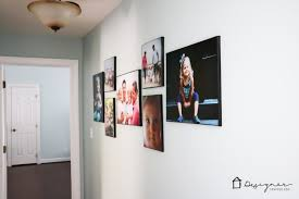 LOVE how this blogger added personality to her hallway with this gorgeous  wall gallery full of