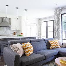 modern dark gray sectional with orange chevron pillows