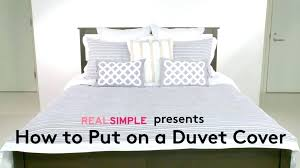 what do you put inside a duvet cover how can you put a duvet cover on