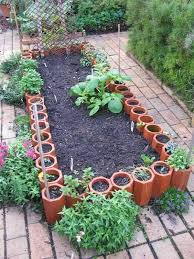 garden beds. diy raised garden beds from old terracotta pipes