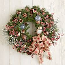 Nature-inspired Christmas wreath with owl, berries, branches, and large  snowflake-