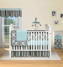 wooden white baby crib with brown blue bedding sets
