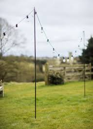 garden poles. the festoon pole can be positioned around garden allowing beautiful lights to hang beautifully poles