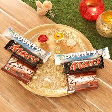 tikka thali with bounty mars galaxy chocolates