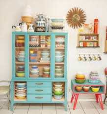 amazing pyrex collection in painted vine cabinet contrasting painted side table by danny