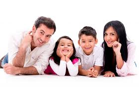 happy family smiling isolated over a white background