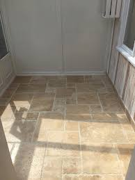 i m so pleased with the final look of the floor and i ve complemented it with wood effect wallpaper which ties in with the natural tones of the travertine