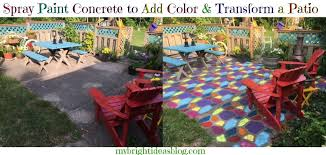 give a tired old grey patio a complete makeover by spray painting a concrete mold to