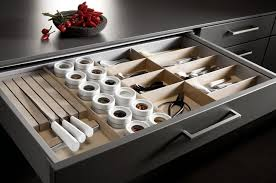 a tailormade storage drawer with sections for knives flatware es and other tools from