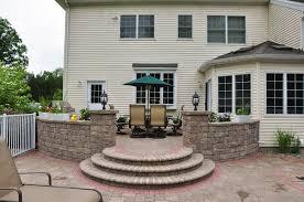 raised patio pavers. Raised Patio Against House. Patios House Pavers