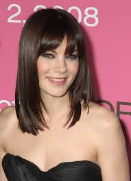 shoulder length straight hair with side bangs
