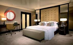 bedroom luxurious traditional master bedroom design with high cream tufted headboard and round red frame