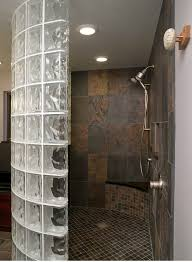 a curved glass block walk in shower with a tile shower pan innovate building solutions
