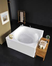 the strikingly beautiful and versatile style and square shape of the liquid space freestanding bathtub means this fixture can be installed in a corner