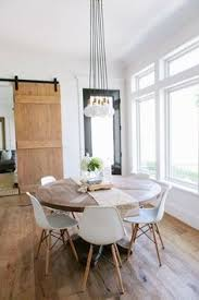 the perfect dining room for those want to keep more cal and simple a less formal eating e the room allowed for a round dining table which we love
