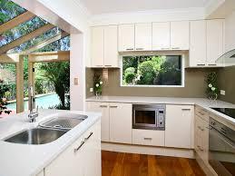 white laminate kitchen countertops. Impressive L Shaped Kitchen With Island Design Also White Laminate Countertops And Full Overlay
