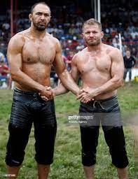 Wrestlers Ali Gurbuz and Ismail Balaban pose for a photo prior to... News  Photo - Getty Images