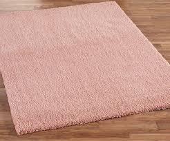 light pink area rug for nursery design