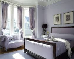 Large traditional master medium tone wood floor bedroom idea in San  Francisco with purple walls