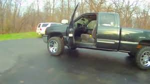 2004 Chevy Silverado with Rough Country leveling kit and 20x12 ...
