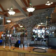 clubhouse restaurant lounge featuring a stone fireplace wrap around deck and excellent food there s no better place to relax after a great round of