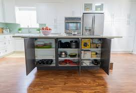 secret cabinet storage under island for extra kitchen items you don t use daily